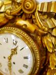 An antique golden clock, close-up.